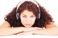 Thoughtful teenager with headphones Stock Images