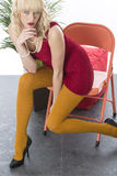 Thoughtful Thinking Attractive Young Woman Sitting on Edge of Chair Royalty Free Stock Photo
