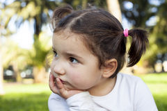 Thoughtful three years old little girl Royalty Free Stock Photos