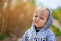 Thoughtful tired child. The thoughtful tired child in a hood Royalty Free Stock Images