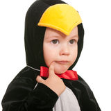 Thoughtful toddler in a penguin carnival suit Stock Photo