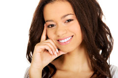 Thoughtful toothy smiling woman. Stock Photo