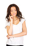 Thoughtful toothy smiling woman. Royalty Free Stock Photography