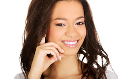 Thoughtful toothy smiling woman. Royalty Free Stock Image