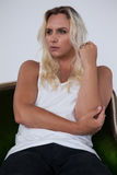 Thoughtful transgender woman sitting on chair Royalty Free Stock Photography