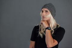 Thoughtful transgender woman wearing knit hat Royalty Free Stock Images