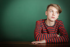Thoughtful trendy young teenage boy Stock Images