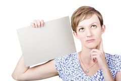 Thoughtful undecided woman holding blank card Stock Photography