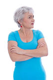 Thoughtful view: isolated elderly woman in a turquoise shirt. Stock Photos