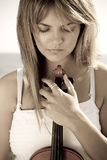 Thoughtful violinist Stock Images