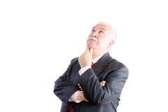 Thoughtful white haired senior businessman Stock Photo