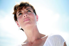 Thoughtful Woman. A beautiful woman backlit by the sun Stock Photos