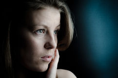 Thoughtful woman. Portrait of a thoughtful young woman Royalty Free Stock Photos