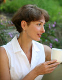 Thoughtful woman. Beautiful mature woman with a cup of coffee Stock Photo