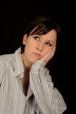 Thoughtful woman Stock Image
