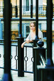 Thoughtful woman against a railing. Stock Photos