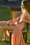 Thoughtful woman on armchair outdoor Royalty Free Stock Image