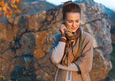 Thoughtful woman in autumn outdoors in evening Royalty Free Stock Images