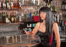 Thoughtful Woman in Bar with Martini Royalty Free Stock Photos