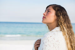 Thoughtful woman at beach Stock Images