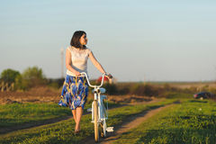 THoughtful Woman with Bicycle Royalty Free Stock Photo