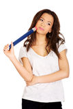 Thoughtful woman with big pencil. Stock Photography