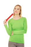 Thoughtful woman with big pencil. Stock Images