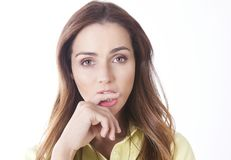 Thoughtful woman biting finger Stock Photo