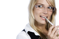 Thoughtful woman biting her pen Stock Photography