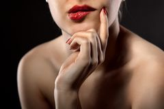 Thoughtful woman on black Stock Photography