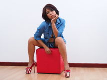 Thoughtful woman in blue denim and high heels Royalty Free Stock Images