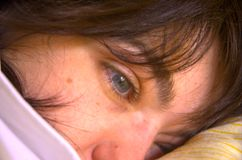 Thoughtful woman of blue eyes. Royalty Free Stock Photography