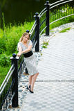 Thoughtful woman on the bridge. Royalty Free Stock Photo