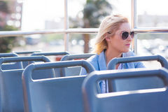 Thoughtful woman bus Stock Images