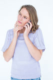 Thoughtful woman calling with her smartphone Stock Photos