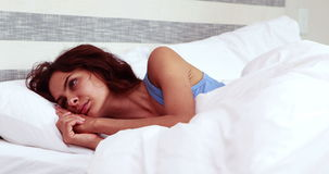 Thoughtful woman can't sleep. In bedroom stock video