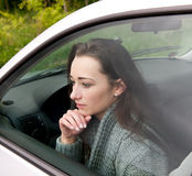 Thoughtful  woman in the car Stock Image