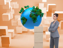 Thoughtful woman with cardboard boxes Royalty Free Stock Photo