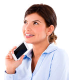 Thoughtful woman with a cell phone Stock Photos