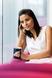 Thoughtful woman coffee shop Stock Image