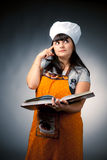 Thoughtful woman cook Stock Photography