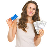 Thoughtful woman with credit card and dollars Stock Photos