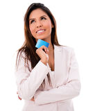 Thoughtful woman with a debit card Stock Images