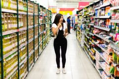 Thoughtful woman doing house shopping for pantry stock images