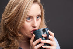 Thoughtful woman drinking Stock Photos