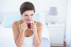 Thoughtful  woman drinking cup of tea Royalty Free Stock Photography