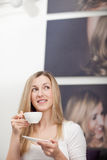 Thoughtful woman drinking a cup of tea Stock Images