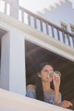 Thoughtful woman drinking white wine in restaurant Royalty Free Stock Images
