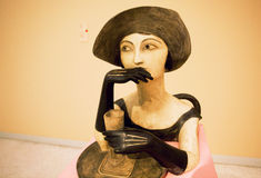 Thoughtful woman drinking wine - Sculpture by famous artist Otto Gutfreund Royalty Free Stock Photos