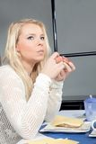 Thoughtful woman eating her breakfast Royalty Free Stock Image
